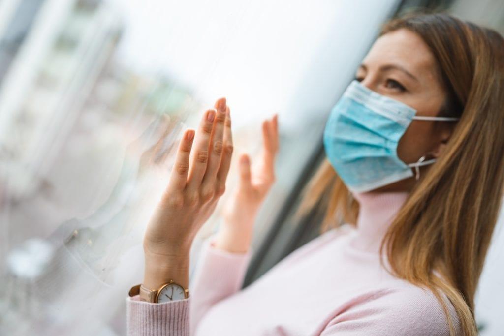 Woman wearing surgical mask for corona virus